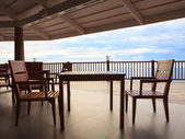 Wood table and wooden desk in pavilion terrace against beautiful — Foto Stock