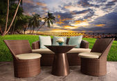 Rattan chairs in outdoor terrace living room against beautiful s — Stock Photo