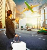 Traveler man and luggage standing on traffic and looking to time — Stock Photo