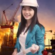 Female engineer with construction plant against building stuctur — Stock Photo #56022479
