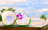 Twon half of green coconut water on top  wood table with tropica — 图库照片