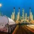 Petroleum container truck and beautiful lighting of oil refinery — Stock Photo #56282687