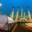 Petroleum container truck and beautiful lighting of oil refinery — Stock Photo #56283835