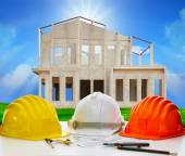 Hard hat of engineering on working table with plan and writing t — Stockfoto