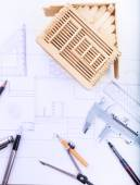 Architect working table with plan home model and writing instrum — Stock Photo