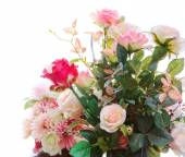 Beautiful artificial roses flowers bouquet arragngement isolated — Stock Photo