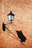 Old vintage retro street lamp on brick wall with copy space back — Stock Photo