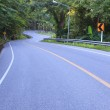 Curve of asphalt road in mountain high ways and jungle beside us — Stock Photo #58098307