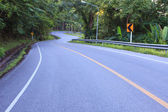 Curve of asphalt road in mountain high ways and jungle beside us — Stockfoto