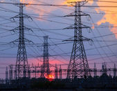 Beautiful sunset behind electricity plant industry estate use as — Stockfoto