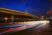 Traffic lighting on rush hour road and express ways bridge again — Stock Photo
