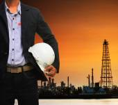 Engineering man and safety helmet standing against beautiful dus — Stock Photo