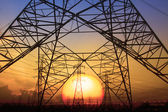 Silhouette sunset scene of high voltage electrical pole structur — Stock Photo