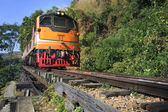 Trains running on death railways track crossing kwai river in ka — Stock Photo