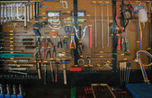 Hand tool kit object arrangement on car auto service and maintenance wall — Stock Photo