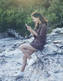 Young beautiful woman connecting people by smart phone on sea si — Stock Photo
