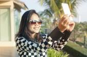 Portrait of young beautiful woman wearing sun glasses take a pho — Stock Photo