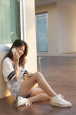 Portrait of beautiful young and teen woman talking mobile phone — 图库照片