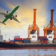Container ship loading on port and cargo plane flying above for water and air transportation industry — Stock Photo #62341845