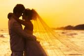 Groom and bride in love emotion romantic moment on the beach  — Foto de Stock