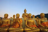Golden buddha statue in temple with beautiful morning light agai — Stock Photo