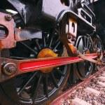 Iron wheels of stream engine locomotive train on railways track  — Stock Photo #62988643