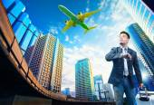 Young business man and belonging luggage standing against buildi — Stock Photo