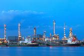 Oil tanker ship on port against beautiful lighting in dusky sky  — Stock Photo