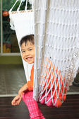 Face of children sitting in clothes cradle and smiling use for f — Stock Photo