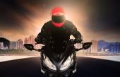 Close up rider man wearing safety suit and anti knock helmet rid — Stok fotoğraf