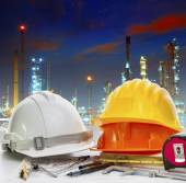 Engineer working table against oil refinery industry plant use f — Stock Photo
