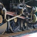 Iron wheels of stream engine locomotive train on railways track  — Stock Photo #68745387