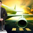 Young business man and traveling luggage standing in front of pa — Stock Photo #71670473
