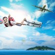 Young man flying on blue sky wearing snorkeling mask and holding — Stock Photo #72667637