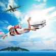 Young man flying from passenger plane to natural destination isl — Stock Photo #72717109
