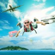 Young man flying from passenger plane to natural destination isl — Stock Photo #72919309