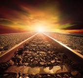 Junction of railways track in trains station agains beautiful li — Stock Photo