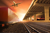 Industry container trains running on railways track  cargo plane — Stock Photo