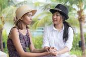 Portrait of young asian woman friends talking to consult serious — Stock Photo