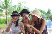 Portrait of asian woman friend group looking to mobile phone and — Stock Photo
