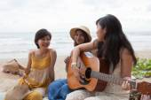 Portrait group of young asian woman playing guitar in sea beach — Stock Photo