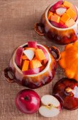 Pumpkin and Apples in Clay Pots — Stock Photo