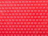 Plastic Red Background with Many Cone Round Dots — Stock Photo