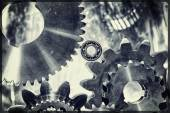 Cogwheels and gears in titanium and steel — Stock Photo