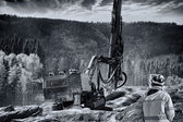 Rock drilling machines and surveying engineer — Stock Photo