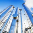 Large oil and gas pipes against clear blue sky — Stock Photo #53804871