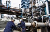 Oil-workers inside oil and gas installtion — Stock Photo