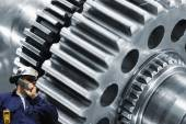 Mechanic with large cogwheels machinery — Foto Stock