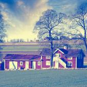 Old farm set in a rural landscape — Stockfoto