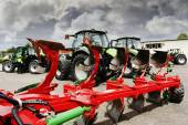 Farming plow and tractors — Stock Photo